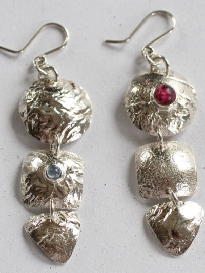 silver gemstone costume earrings