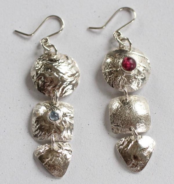 silver gemstone costume earrings